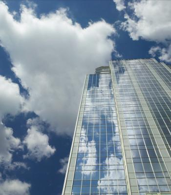 skyscraper with blue clouds