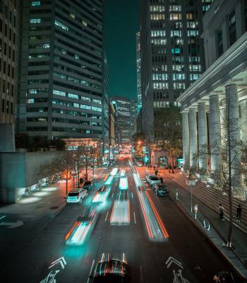 Speeding cars on a city street
