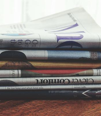 Stack of Newspapers on a Table